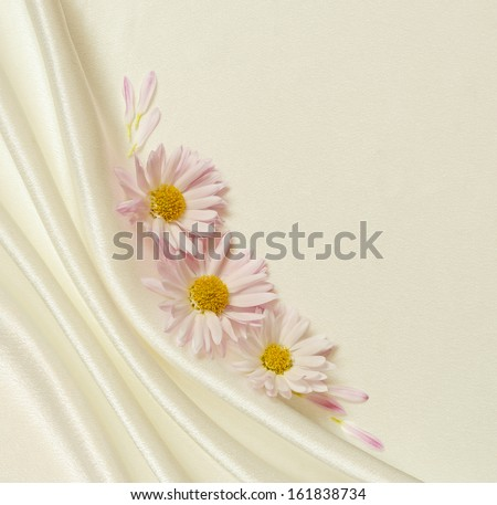 White silk fabric with folds and asters - stock photo