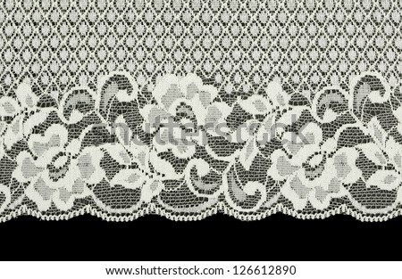 White silk lace in retro style on a black background - stock photo