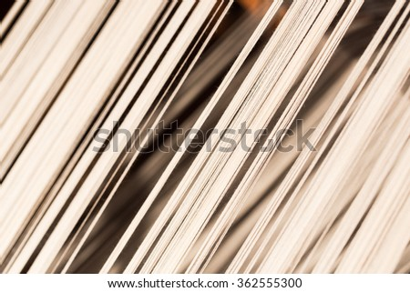 white silk thread in sewing or weaving machine,texture,background - stock photo
