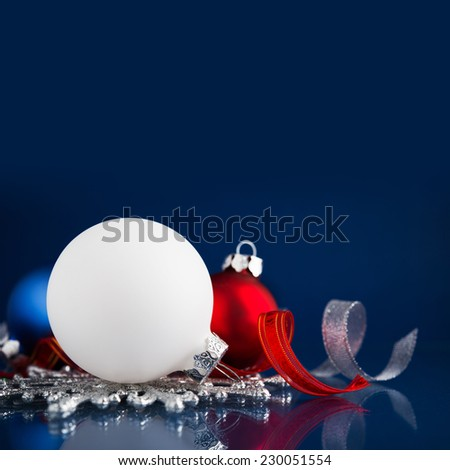White, silver and red christmas ornaments on dark blue background with space for text. Merry christmas card. Winter holidays. Xmas theme. - stock photo