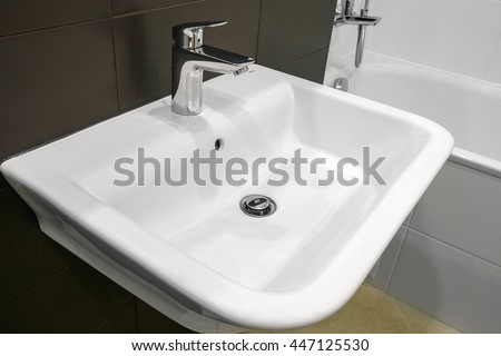 White sink with faucet in the bathroom