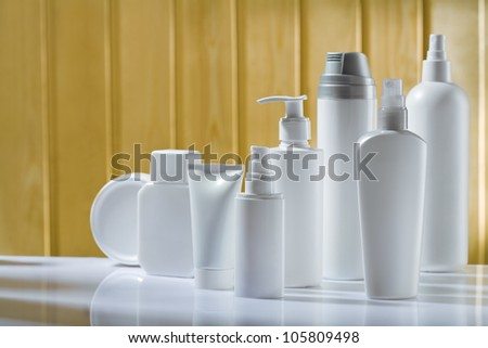 white skincare items on table closeup - stock photo