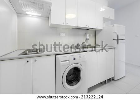 White, small and compact kitchen interior design - stock photo