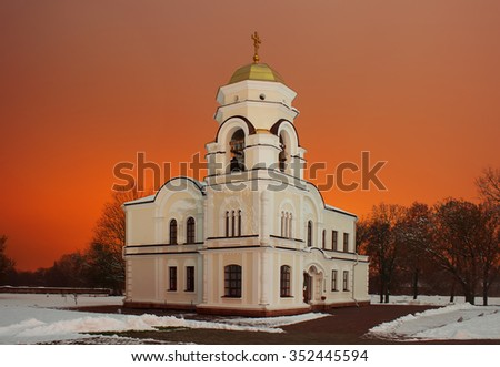 White small church at night on the trees background - stock photo
