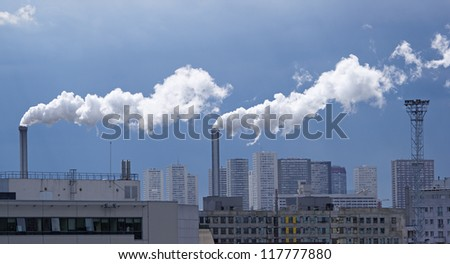 white smoke  and industrial chimney in Paris suburb - stock photo