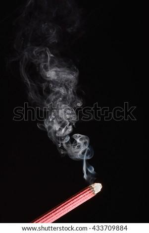 White smoke from burning incense - stock photo