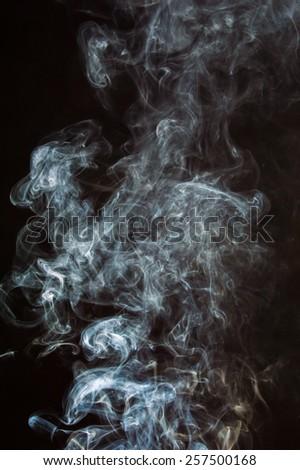 White smoke on a black background. - stock photo