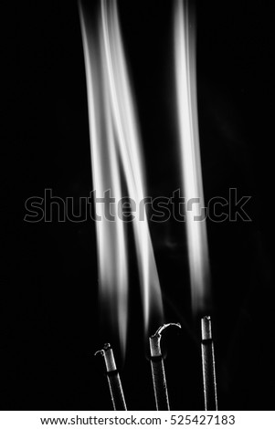 White smoke on a black background.