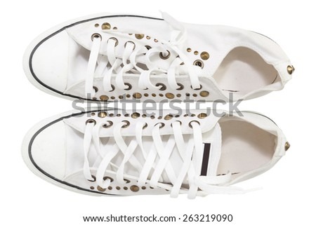 white sneaker shoes with rivets isolate on white background - stock photo