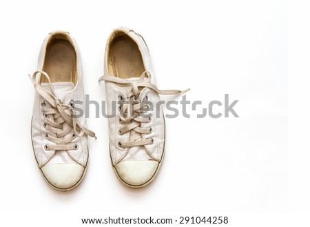 White sneakers on white background for design.