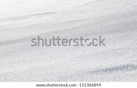 White snow surface background - shallow depth of field - stock photo