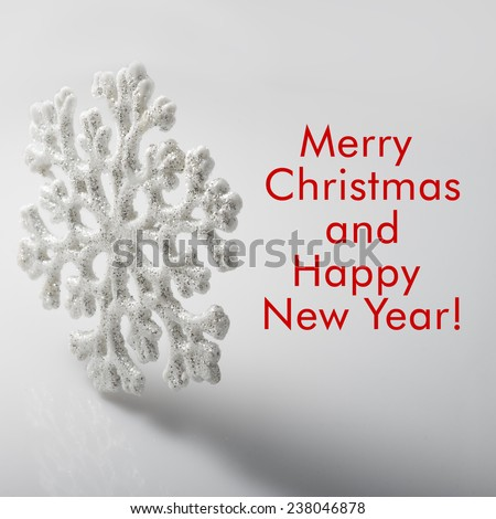 White Snowflake on a white background. Winter symbol. Merry Christmas and Happy New Year 2015! Greeting card. Christmas decoration. - stock photo