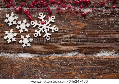 White snowflakes on wooden wall background - stock photo