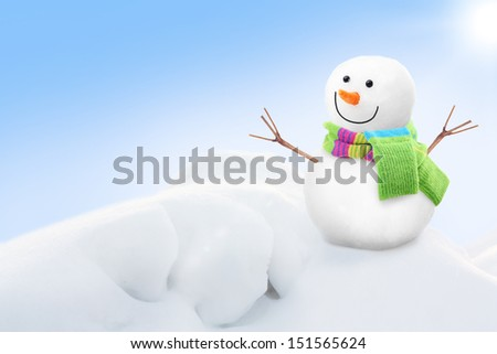 White snowman against blue sky. - stock photo