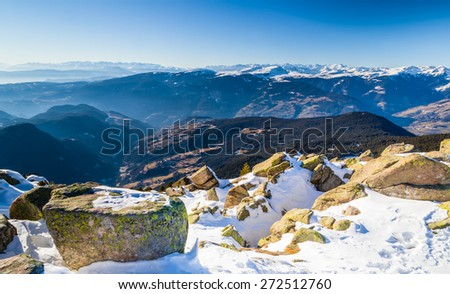 White snowy Dolomites mountains with rocks, snow-capped peaks and green conifers in winter - stock photo