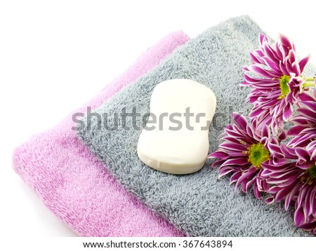 white soap bar on double towel - stock photo