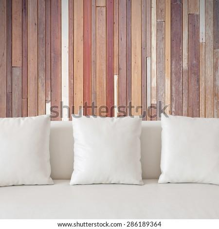 White sofa and wood background. - stock photo