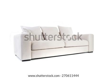 White sofa isolated on white - stock photo