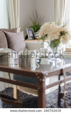 white sofa with brown pillows in living room and blur foreground effect