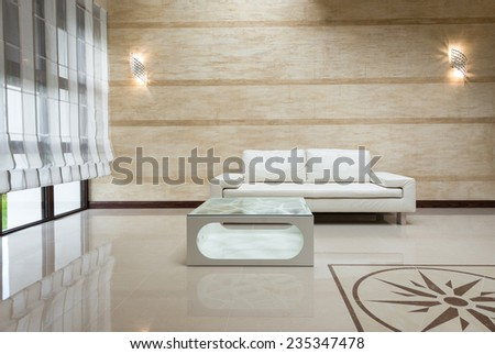 White sofa with coffee table - stock photo
