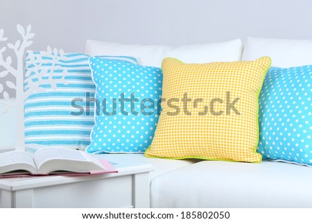 White sofa with colorful pillows in room  - stock photo