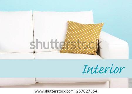 White sofa with pillow on wall background, Interior concept - stock photo
