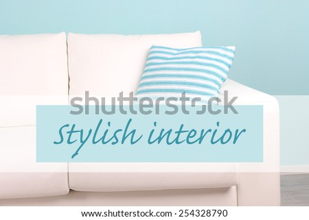 White sofa with pillow on wall background, Stylish interior concept - stock photo