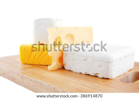 white soft cheeses and yellow danish on wood - stock photo