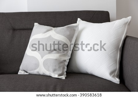 white soft cushion on sofa