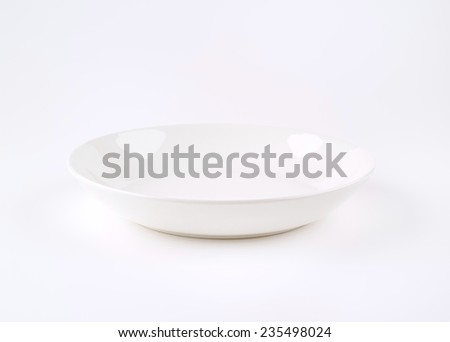 white soup plate on white background - stock photo