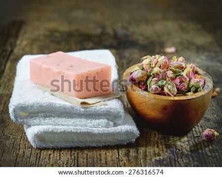 white spa towels and natural rose soap bar on wooden table - stock photo