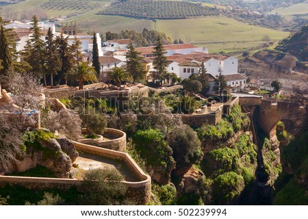 White spanish buildings built on the cliffs edge at Ronda, Spain