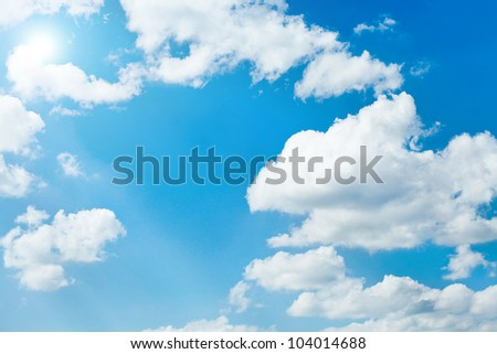 White sparse clouds on blue sky