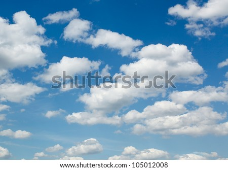 White sparse clouds over blue sky - stock photo
