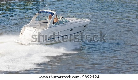 white speedboat at the height of summer - stock photo