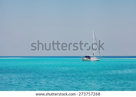 white speedboat yacht  in blue ocean - stock photo