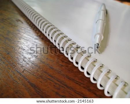 White Spiral Book on table