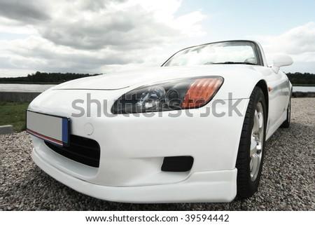 white sport car near the river - stock photo