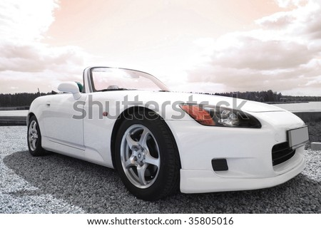 white sport car on the road - stock photo