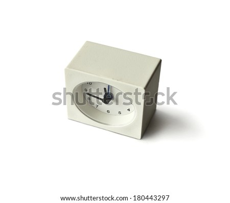 White square Alarm clock shawing almast 12 ocklock isolated on a white background