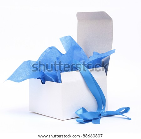White square gift box with blue tissue and matching ribbon