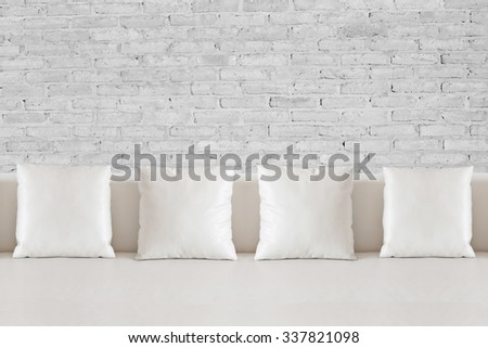 White square pillow on white sofa