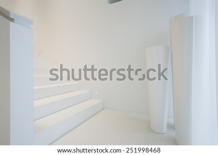 White staircase inside pure and modern house - stock photo