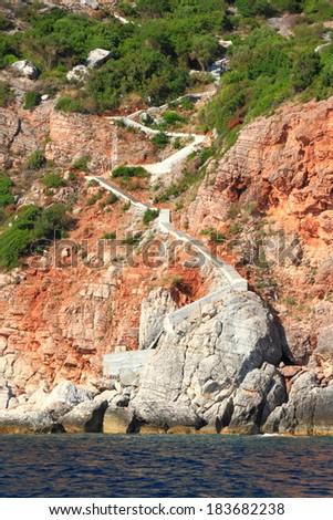 White stairs descending to the coastal line of Adriatic sea - stock photo