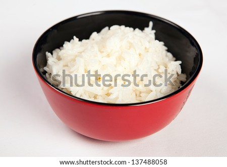 White steamed rice in black round bowl - stock photo