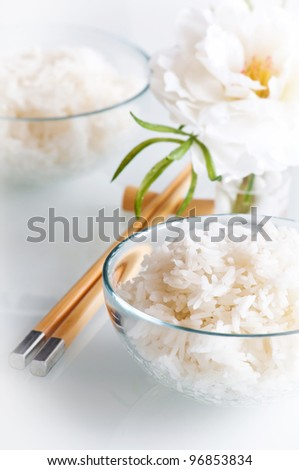 White steamed rice in round bowl and chopstick - stock photo