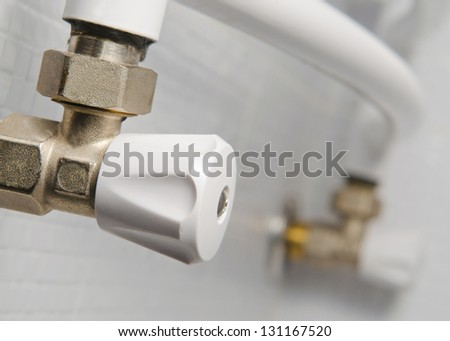 white steel valve for water pipeline - stock photo