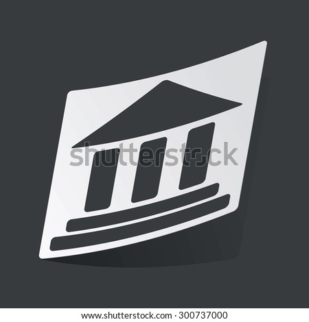 White sticker with black image of classical building with pillars, on black background - stock photo
