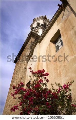 White Stone Church Red Bougainvillea, Tlaquepaque, Guadalajara, Mexico - stock photo