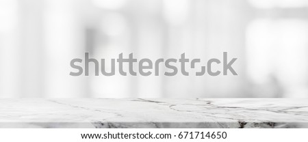 marble table top background. white stone marble table top and blurred abstract background from interior building banner - can e